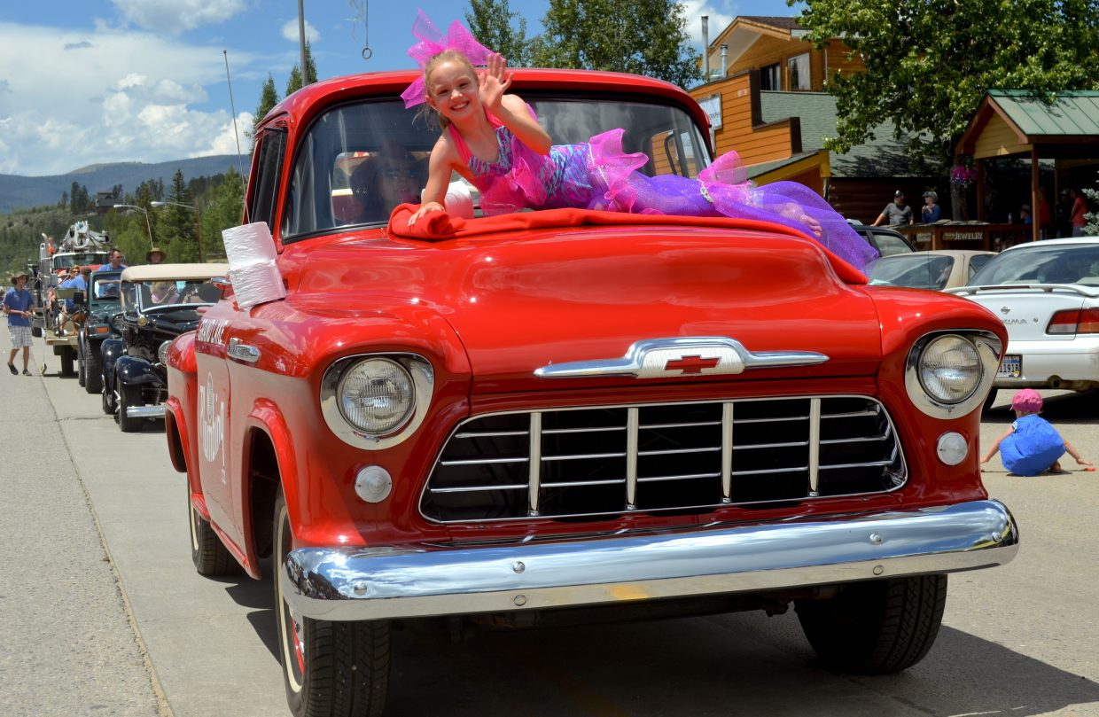 A little mermaid rides atop the hood of the Grand Lake Plumbing truck during the Buffalo Days Parade last weekend.