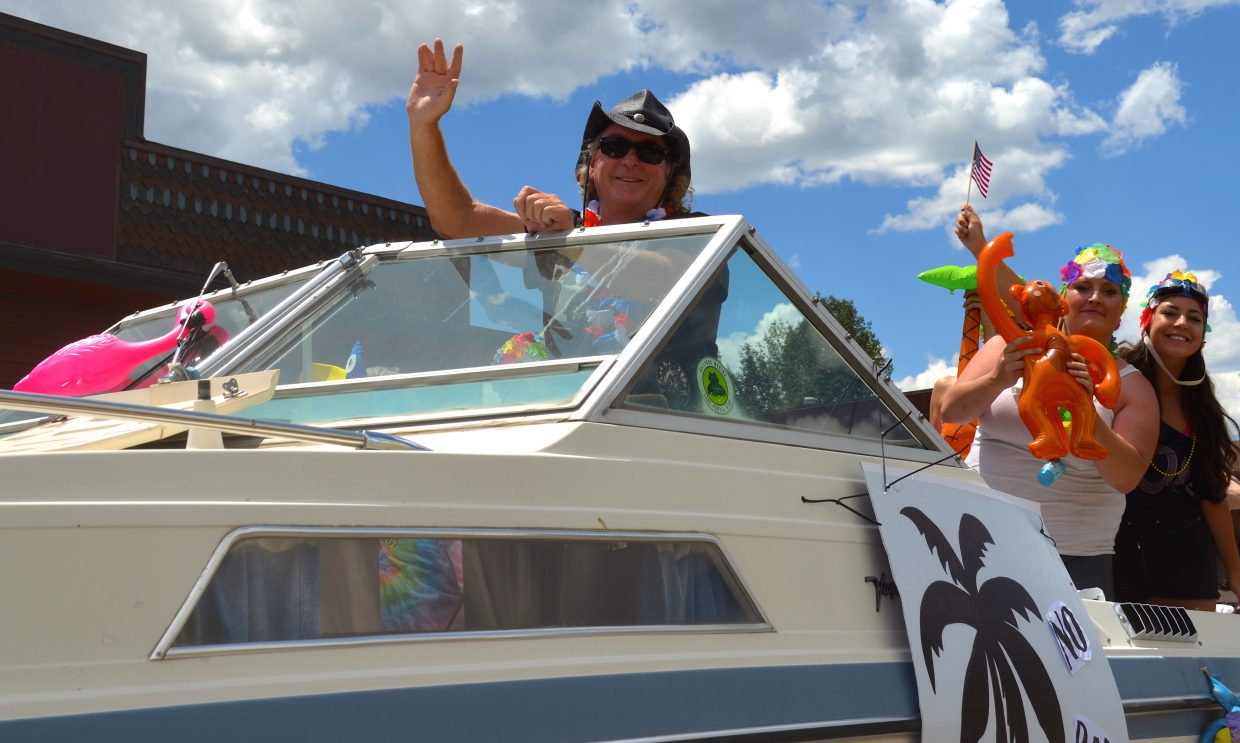 Hayden Burke, wearing hat, was at the helm of the No Bad Days float during Grand Lake's Buffalo Days Parade.