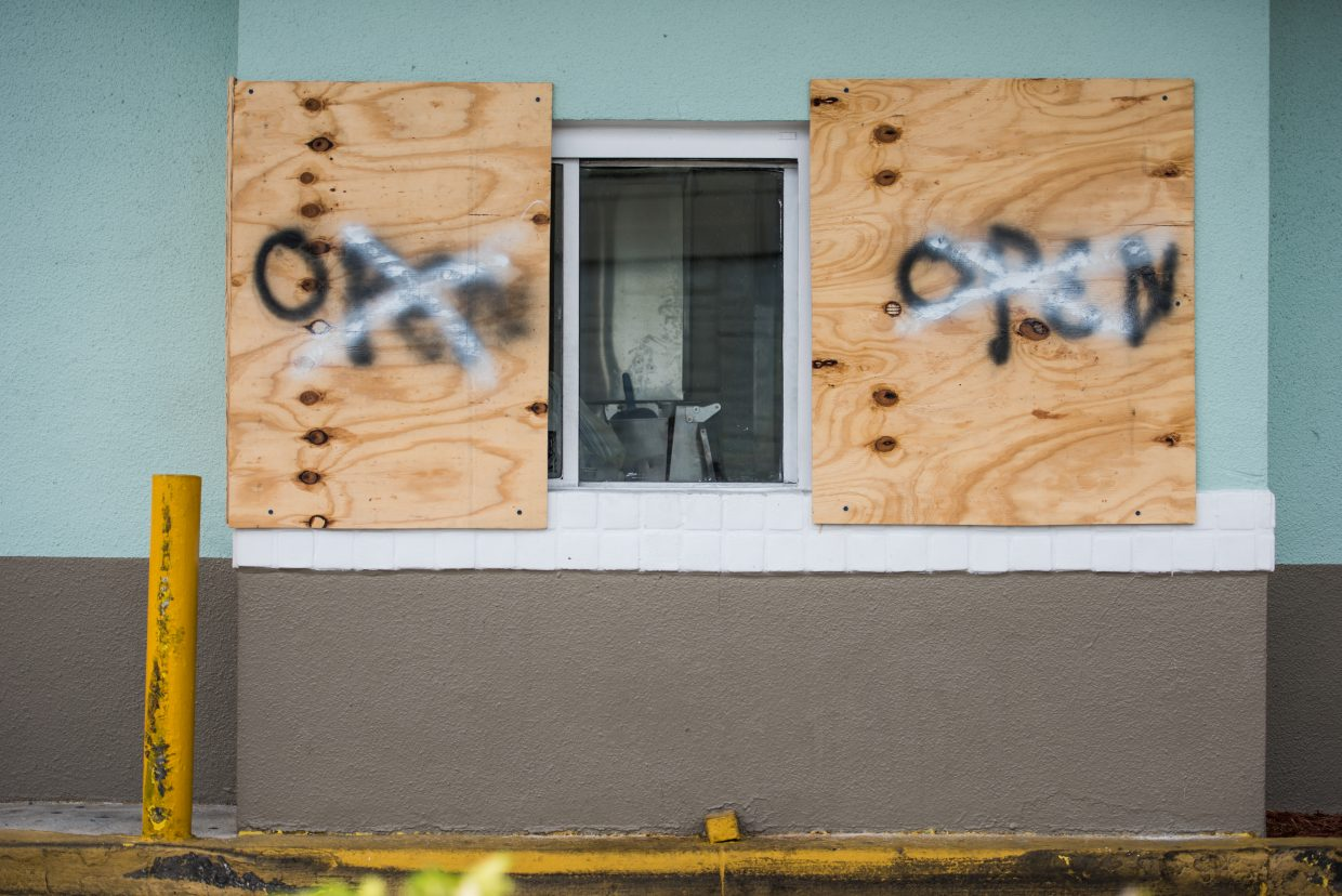 Boarded up shops. (Photo by Tyler Tomasello)