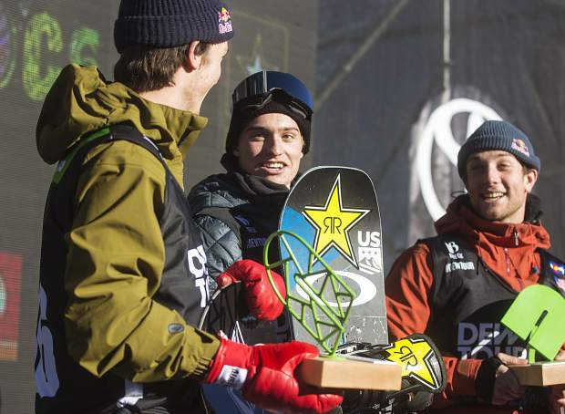 Eagle product Jake Pates, at top of podium, of United States interacts with Scotty James, far left, following the superpipe finals during the Dew Tour event Friday, Dec. 15, at Breckenridge Ski Resort. Pates took home first with a high score of 97.