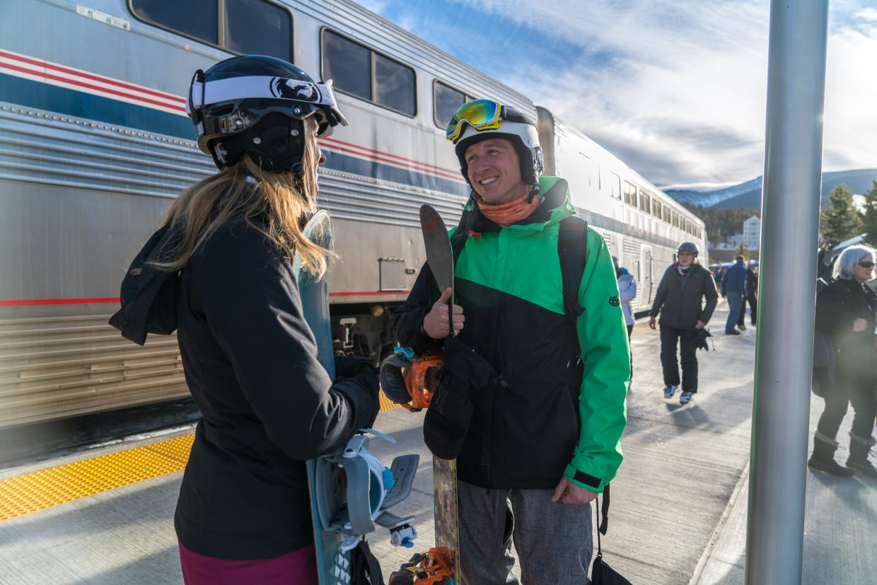 Skiers chat after unloading from the Winter Park Express on Friday. (Photo by Carl Frey/Winter Park Resort)
