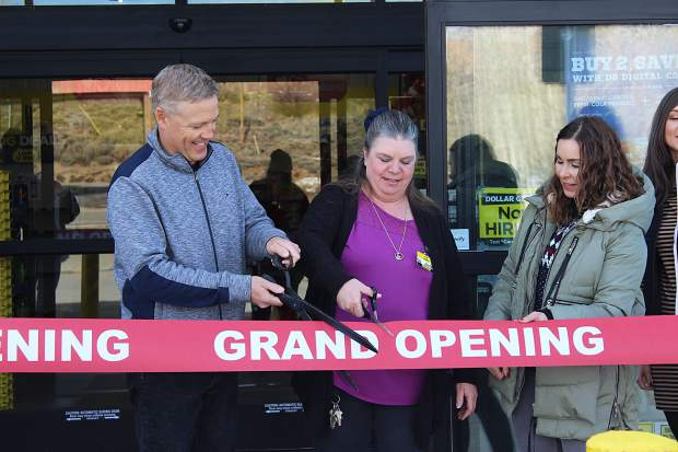 Granby Mayor Paul Chavoustie cuts the ceremonial ribbon on the recently opened Dollar General along with Store Manager Anita McGehee on Friday, Jan. 5, 2018.