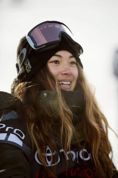 17-year-old Hailey Langland of San Clemente, California smiles at Saturday's U.S. Grand Prix snowboard slopestyle final at Mammoth Mountain, California where Langland's third-place finish clinched her spot at next month's Pyeongchang Winter Olympic Games in South Korea.