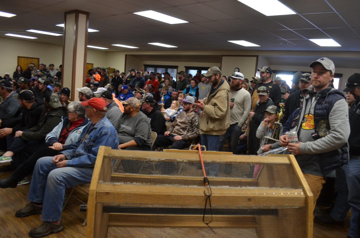 A large crowd of anxious anglers waits in anticipation as contest organizers read out the winning fish during Sunday afternoon's awards ceremony at the Granby Community Center.