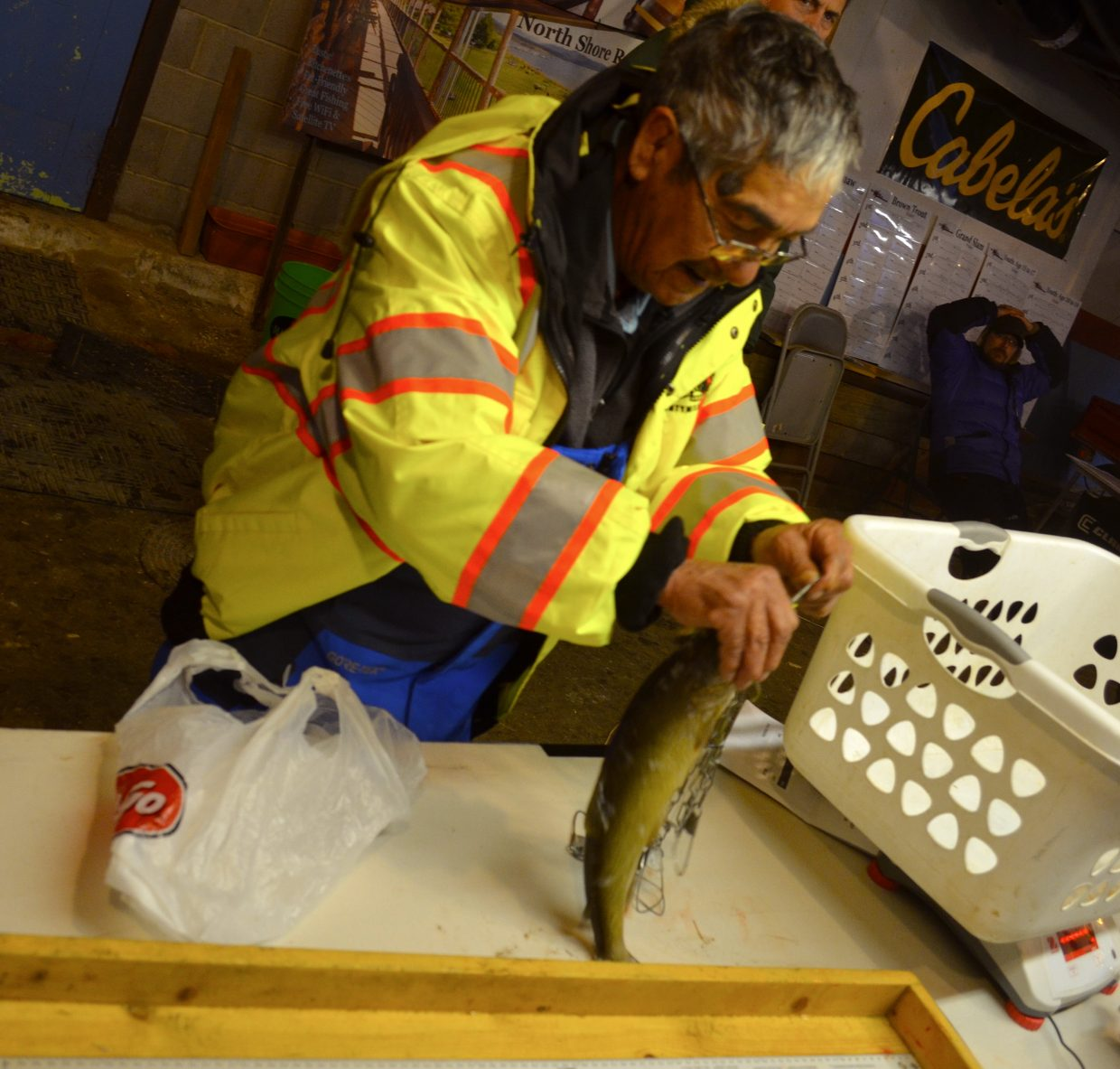 Crecencio Salazar, from Hayden, pulls one of his recent catches out to be weighed at the North Shore Resort over the weekend.
