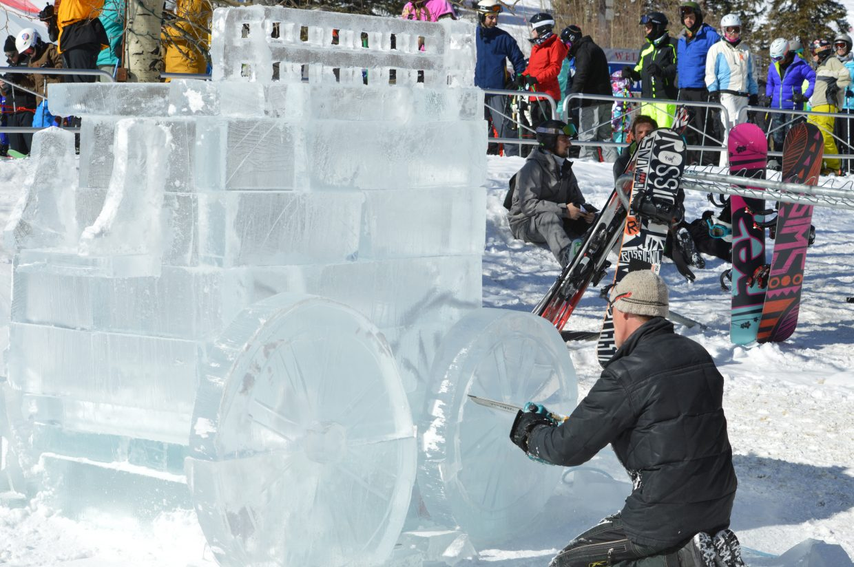 Thomas Barlow sculpts a stagecoach out of ice, his fourth time creating a sculpture for the event.