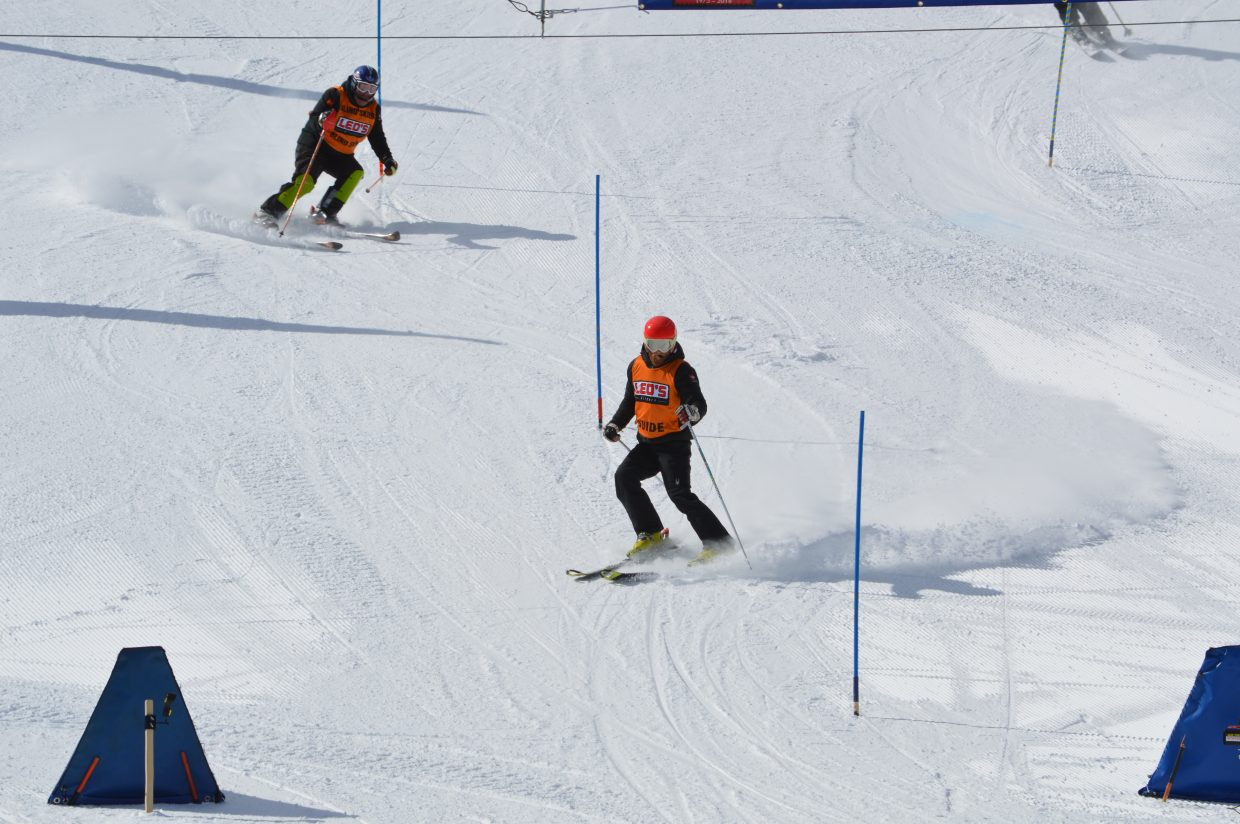 A blind skier follows his guide down the slalom course.