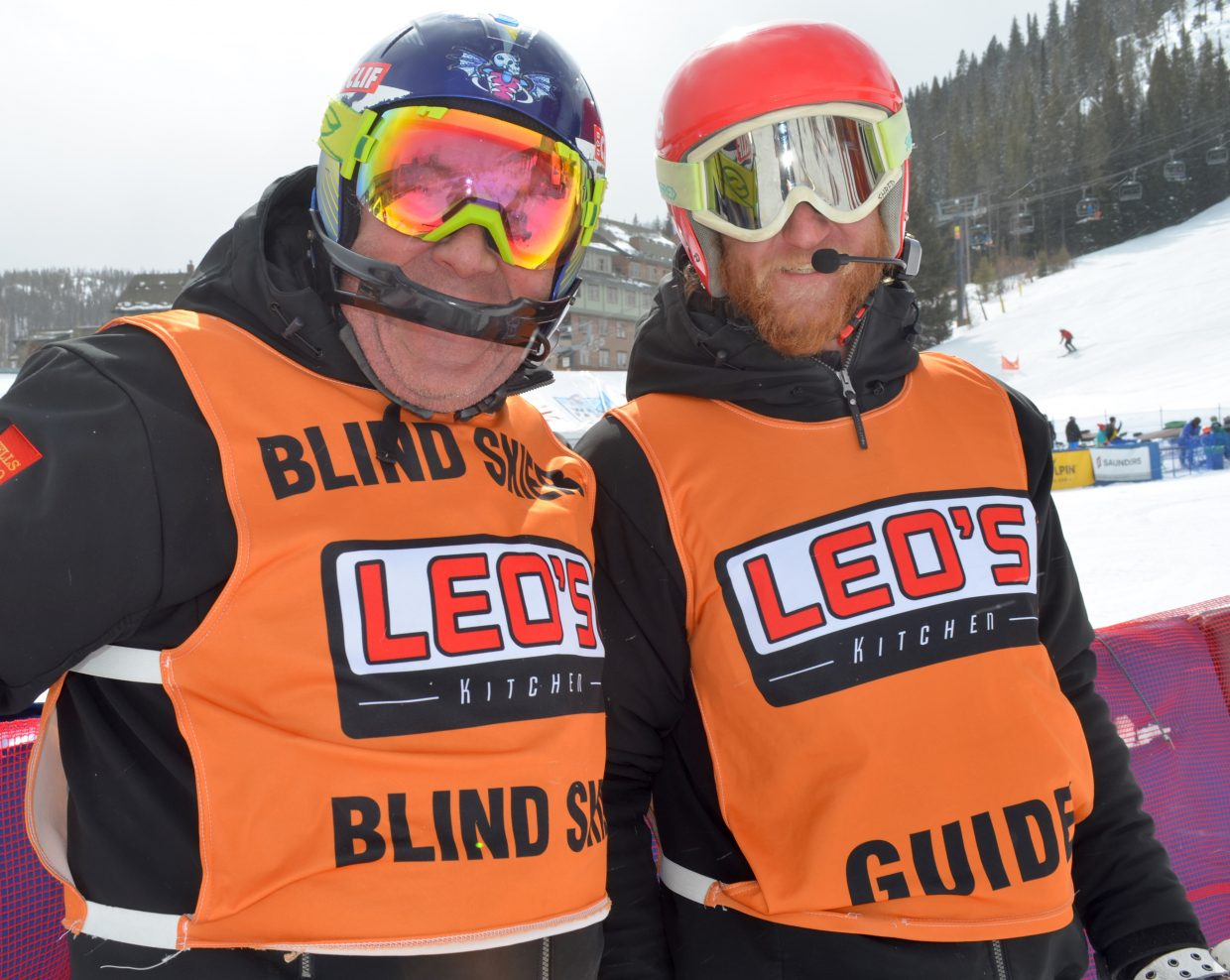 Visually impaired skier Larry Martin (left) pauses briefly with his ski guide Brad Washburn after one of his heats Sunday morning.
