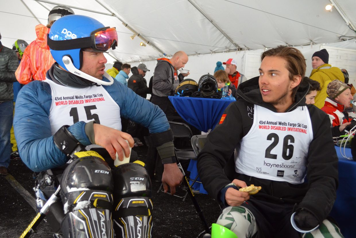 Denver based skier Michael Murphy (left) talks shop with his fellow competitor Josh Crane, of Auckland New Zealand, while warming up inside the event tent at the base of Winter Park Resort.