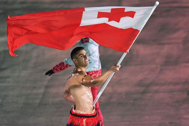 Tonga's Pita Taufatofua carries his nation's flag at the 2018 Winter Olympics in Pyeongchang, South Korea. Taufatofua also carried the flag for his country at the 2016 Summer Olympics, and he did that just like he did Friday's show in ice-cold South Korea, oiled up and shirtless.