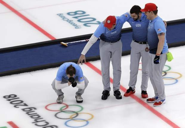 United States team celebrate during the men's curling finals match against Sweden at the 2018 Winter Olympics in Gangneung, South Korea, Saturday, Feb. 24, 2018. United States won gold. (AP Photo/Aaron Favila)