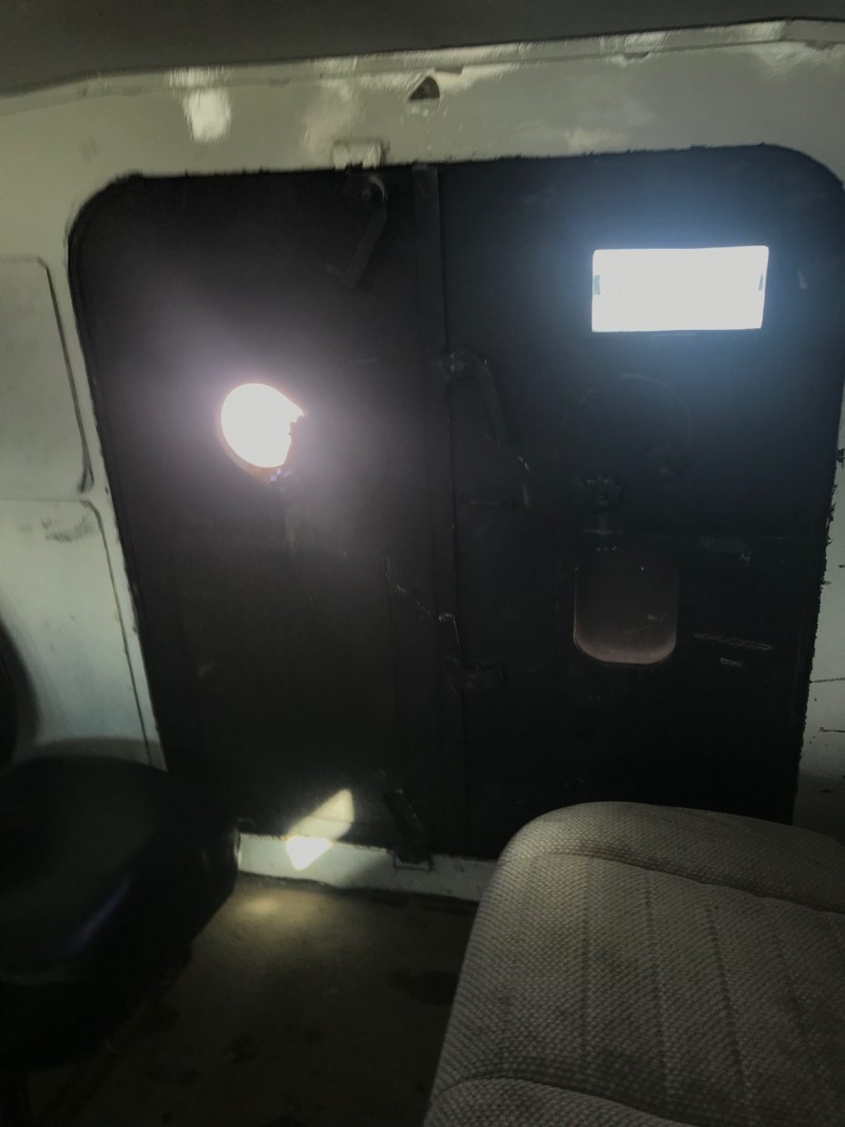 Looking at the armored door inside Grand County's Peacekeeper armored vehicle. Photo by Emma Simmins / Sky-Hi News