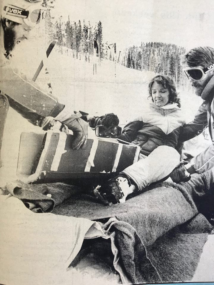 Ski Patrolman Ray Coffey, left, and John Becker, right, gingerly maneuver Diane Watson into a sled on the Cranmer Cutoff at Winter Park. Watson hurt her lower leg, so the patrolmen splinted her leg and gave her a ride down the mountain in a sled.