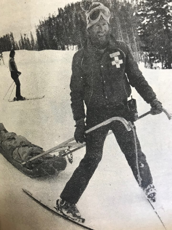 Ray Coffey pulls the sled holding injured skier Diane Watson down the mountain Friday afternoon. The SKi Patrolmen must be skilled in pulling a sled before they are allowed to pull injured skiers down the mountain.