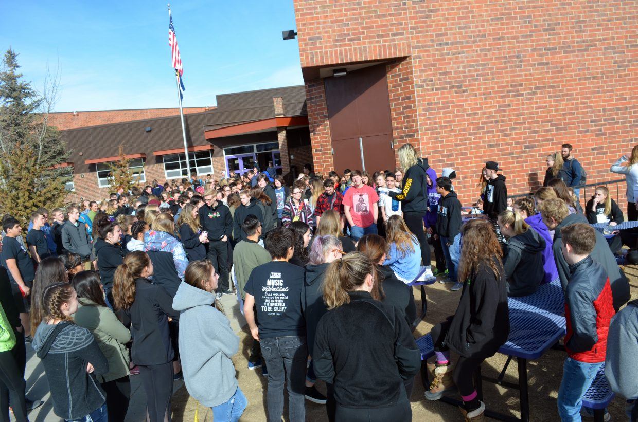 Over 100 students gather in front of Middle Park High School on Wednesday in support of the victims of school shootings.