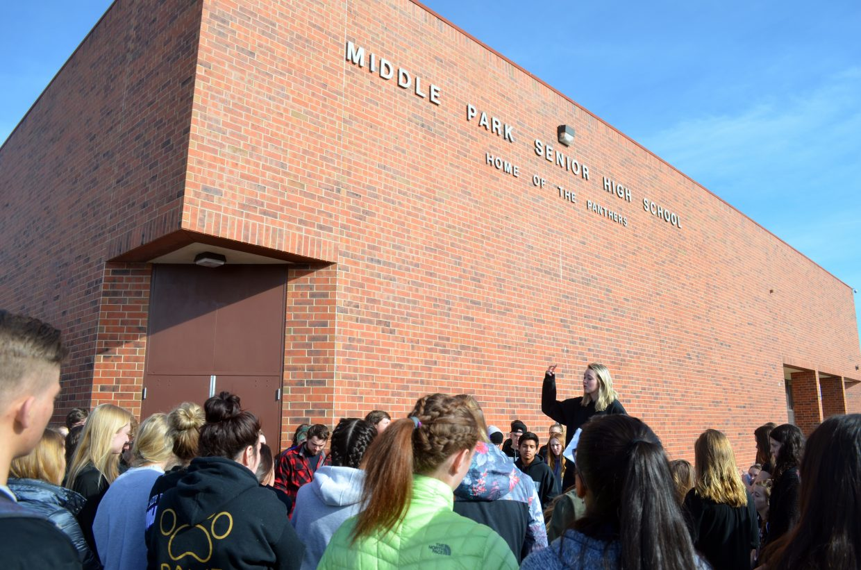 Gigi Newcomer-Neeson speaks during the Wednesday walkout at Middle Park High School.