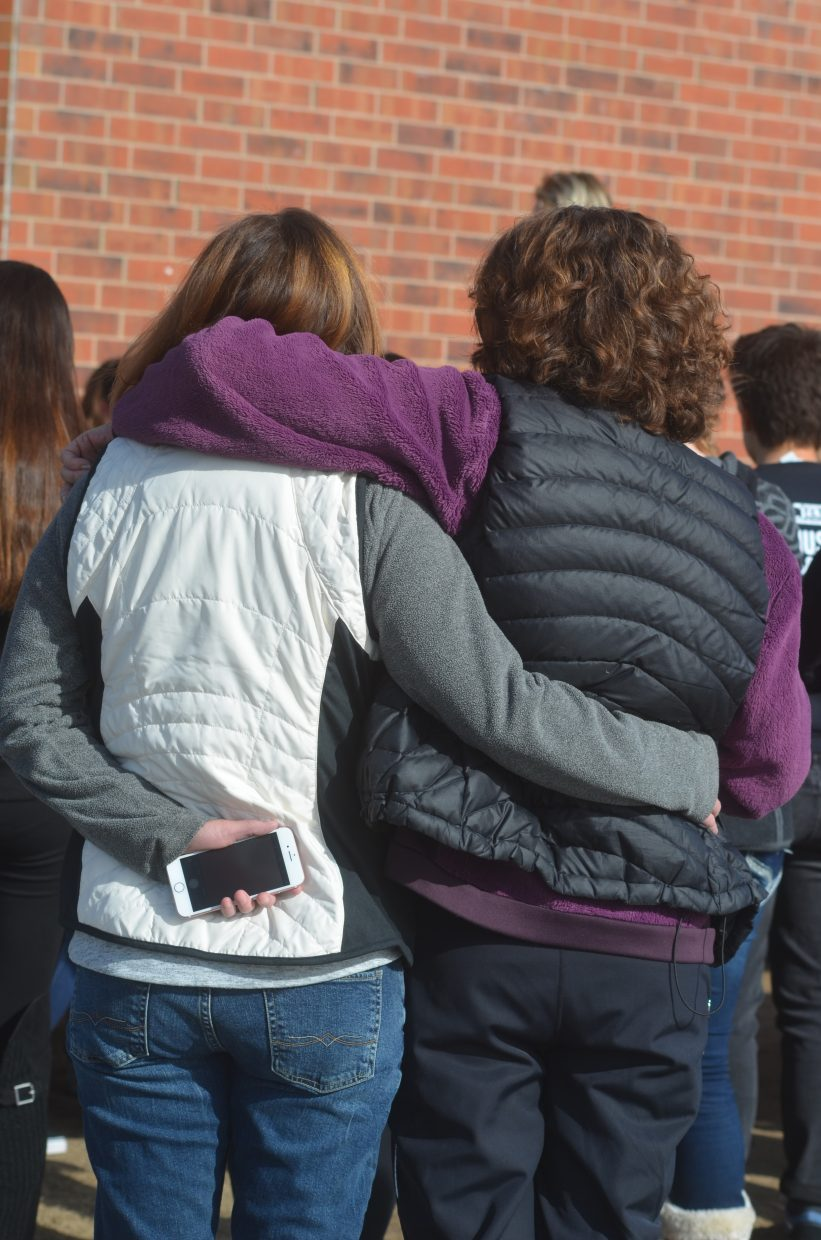 Two female students hug each other during the event Wednesday at Middle Park High School.