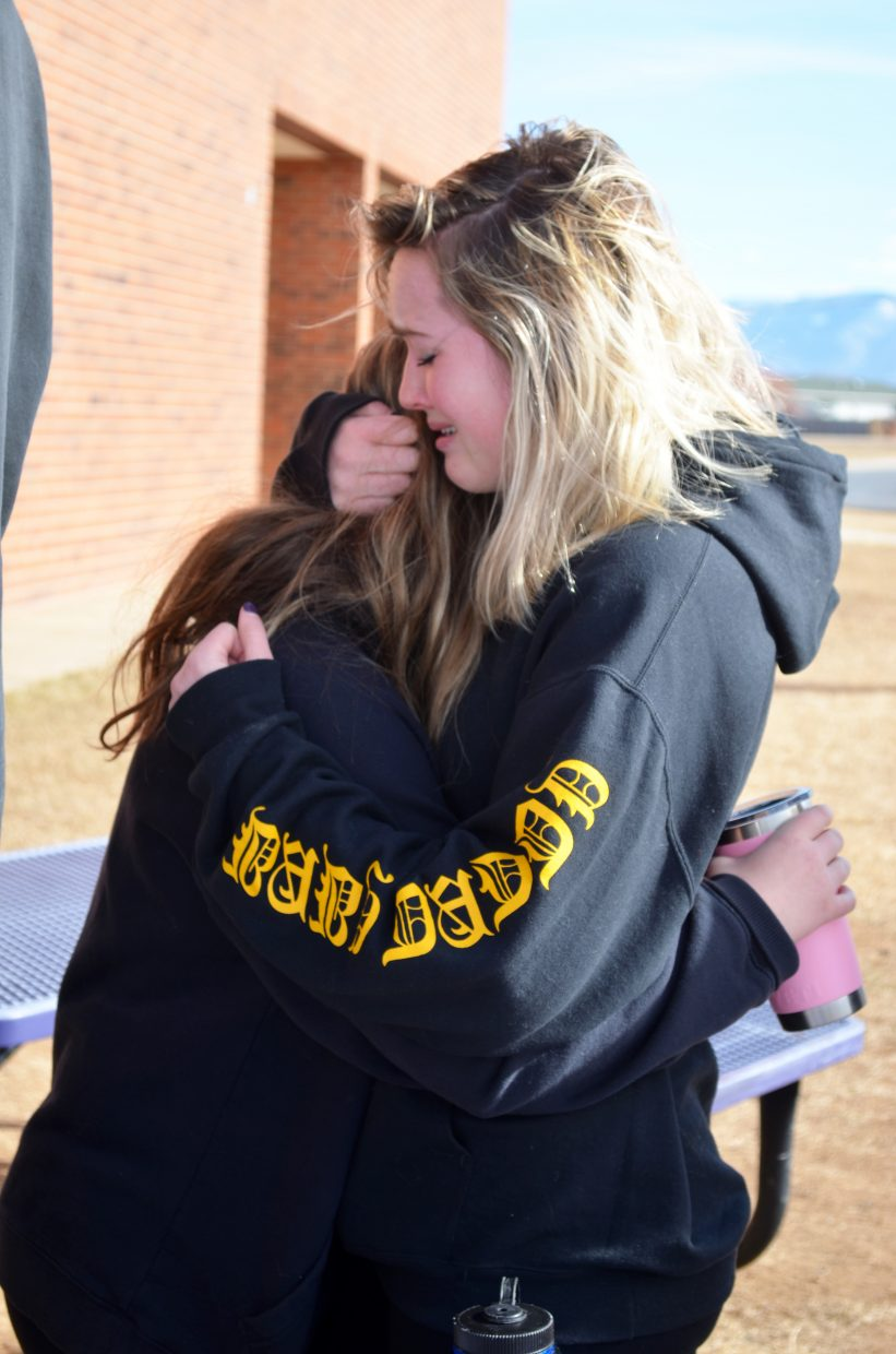 Gigi Newcomer-Neeson, right, hugs a fellow student.