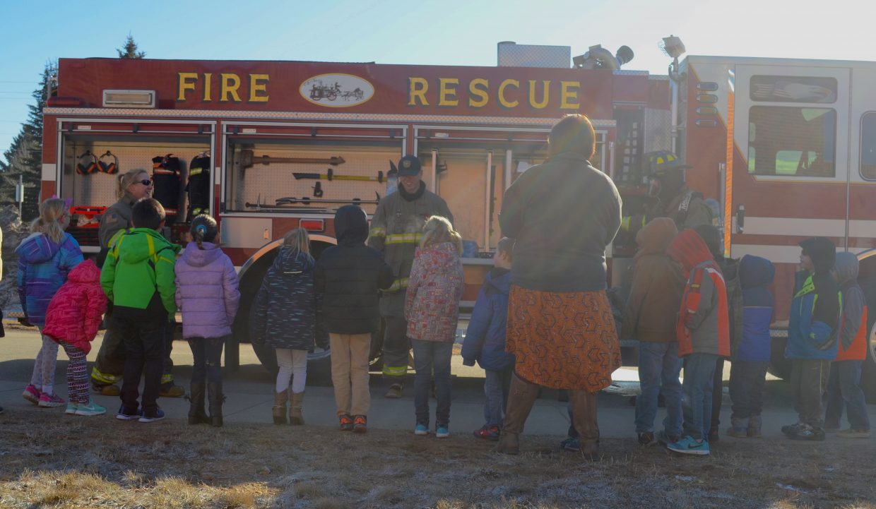 Granby Elementary students look over a fire truck from Grand Fire during Tuesday morning's Career on Wheels presentation.