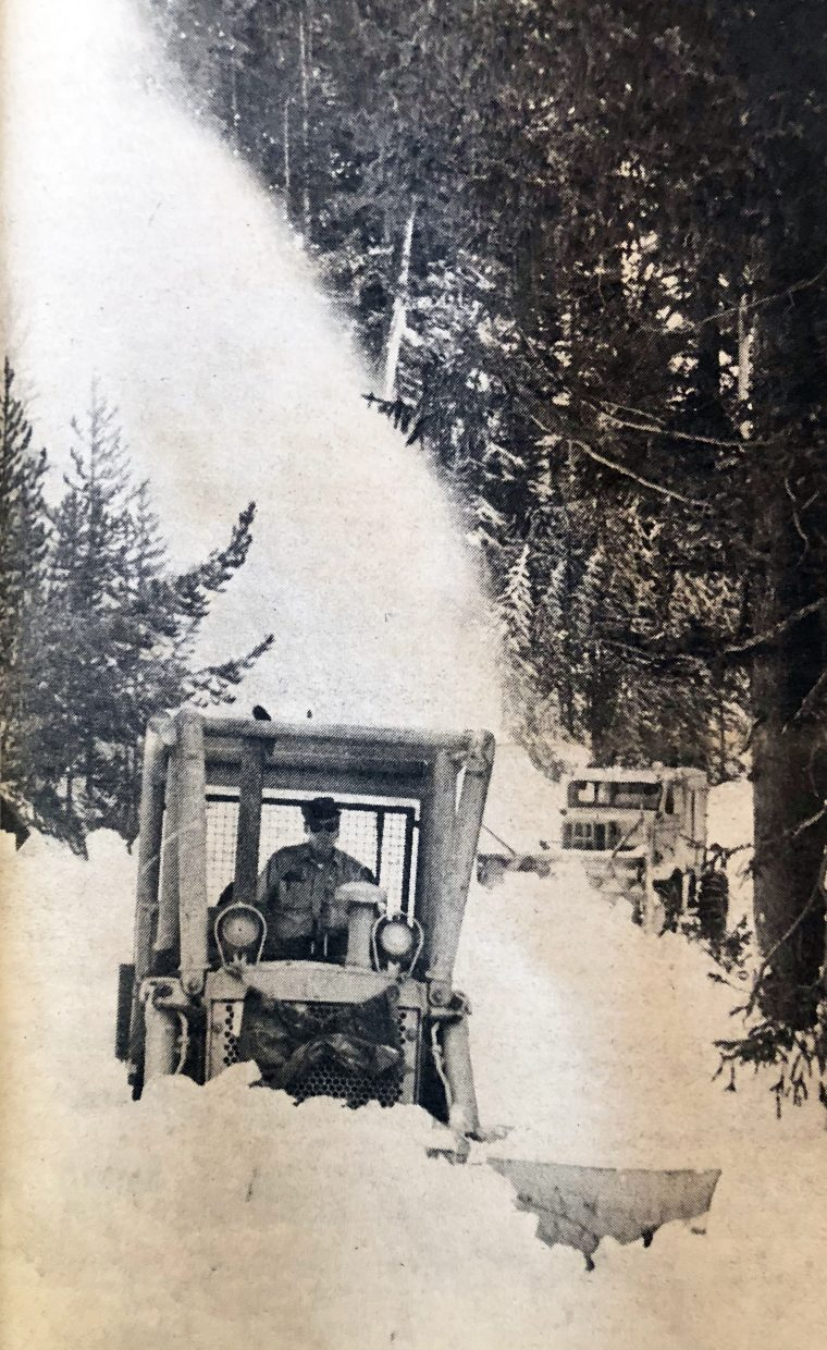 Rocky Mountain National Park maintenance crew members Stewart Dennet is operating the Cat, while Seymour Parkes is following in the rotary blower