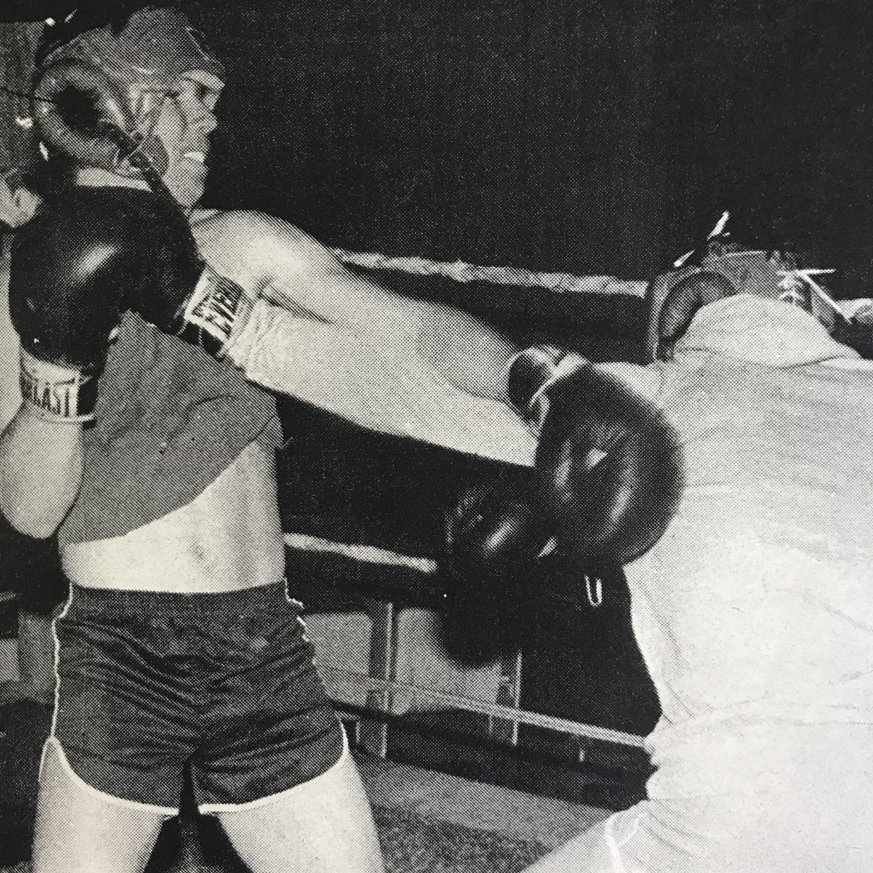 Steve Hunter, left, dodges a straight left hand thrown by Sam Neal as the two boxers spar in preparation for Saturday's boxing matches at the El Grande Theatre in Granby. The two Granby fighters have put in a lot of training time in hopes of winning their bout and a shot at the $250 grand prize.