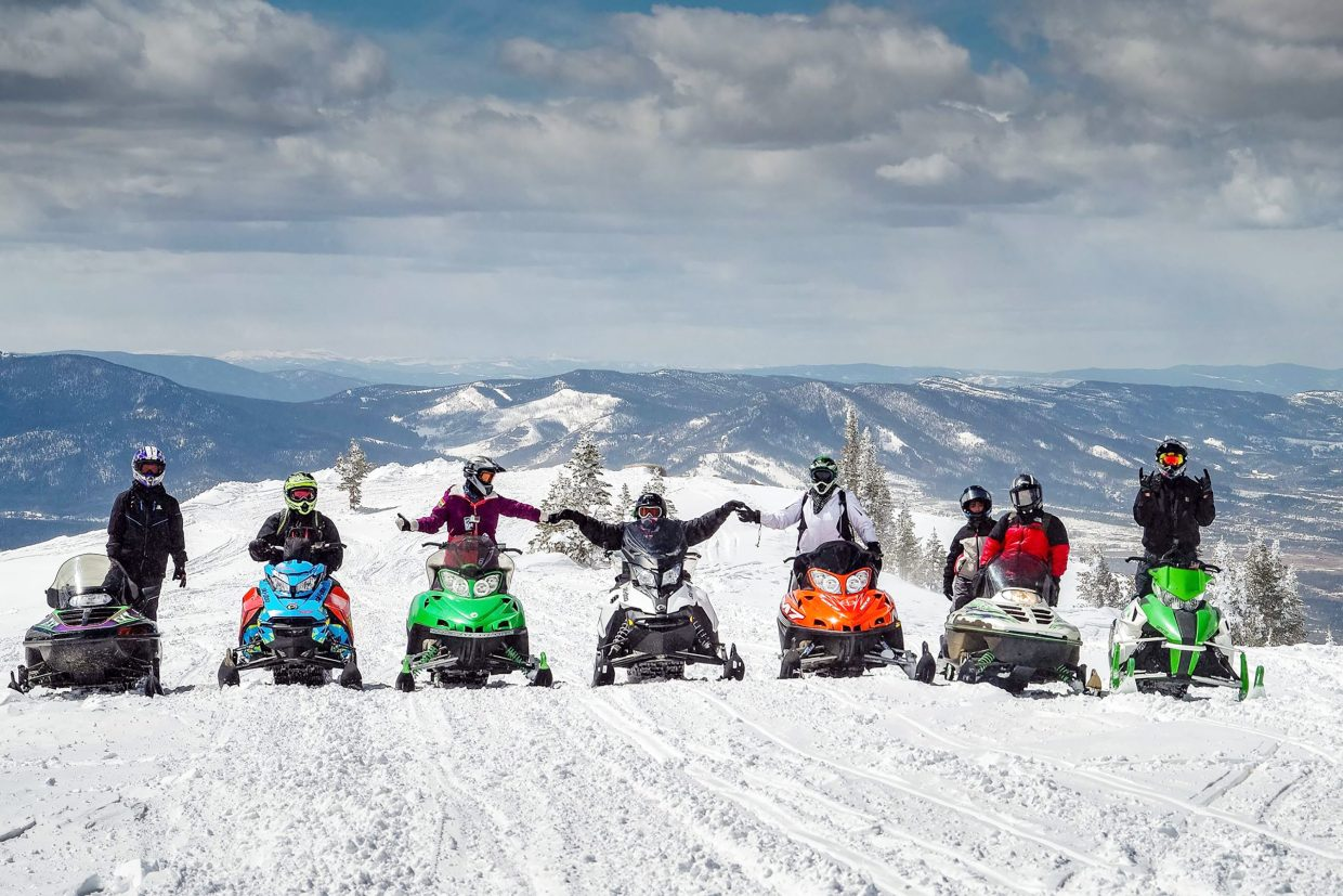Pisano sits atop Corona Pass accompanied by a group of friends who came up for the ride on Sunday, April 15. Members from around the community came together to help modify a snowmobile that allowed Pisano to drive.