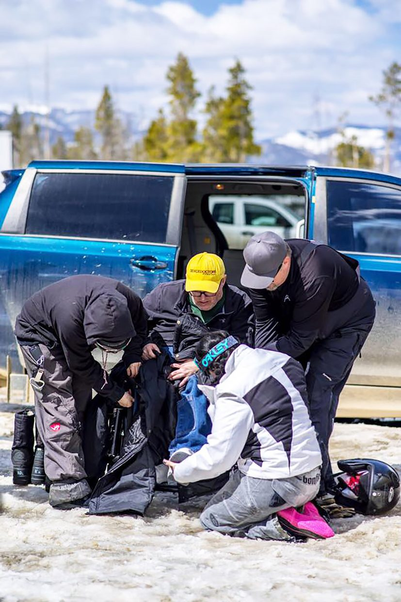 Steve Pisano, owner of Device Doctors in Winter Park, prepares for his trip to the top of Corona Pass on Sunday, April 15 with some help from his friends.