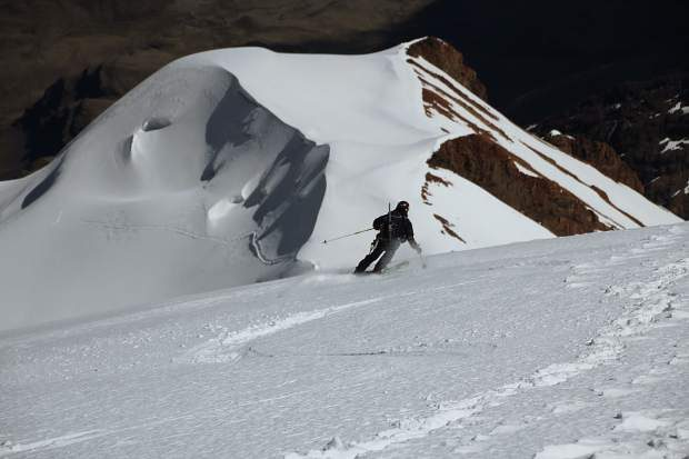Mike Marolt skiing Illimani in 2012 after the second-ever ski descent and first-ever American descent of the 21,150-foot peak in western Bolivia. The Marolts made the first-ever single-day ascent-descent of the peak.