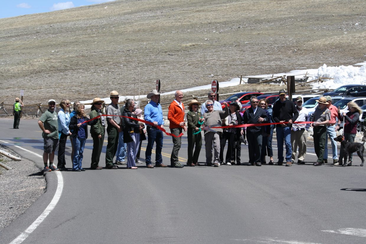A group of officials from either side of the Continental Divide join Rocky Mountain National Park officials in cutting the ceremonial ribbon to officially open Trail Ridge Road on Friday, May 26, 2018.