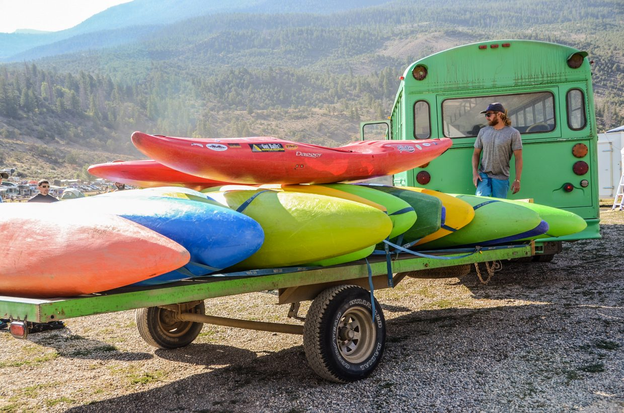 A colorful collection of kayaks sit on a trailer not far from the Colorado River during Gorefest.