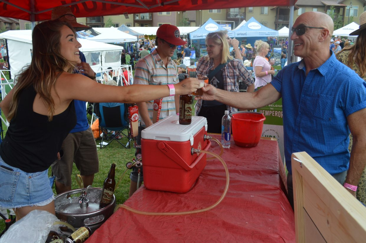 Chris Mueller, from Winter Park, tastes a Fort Collins favorite at the New Belgium Booth.