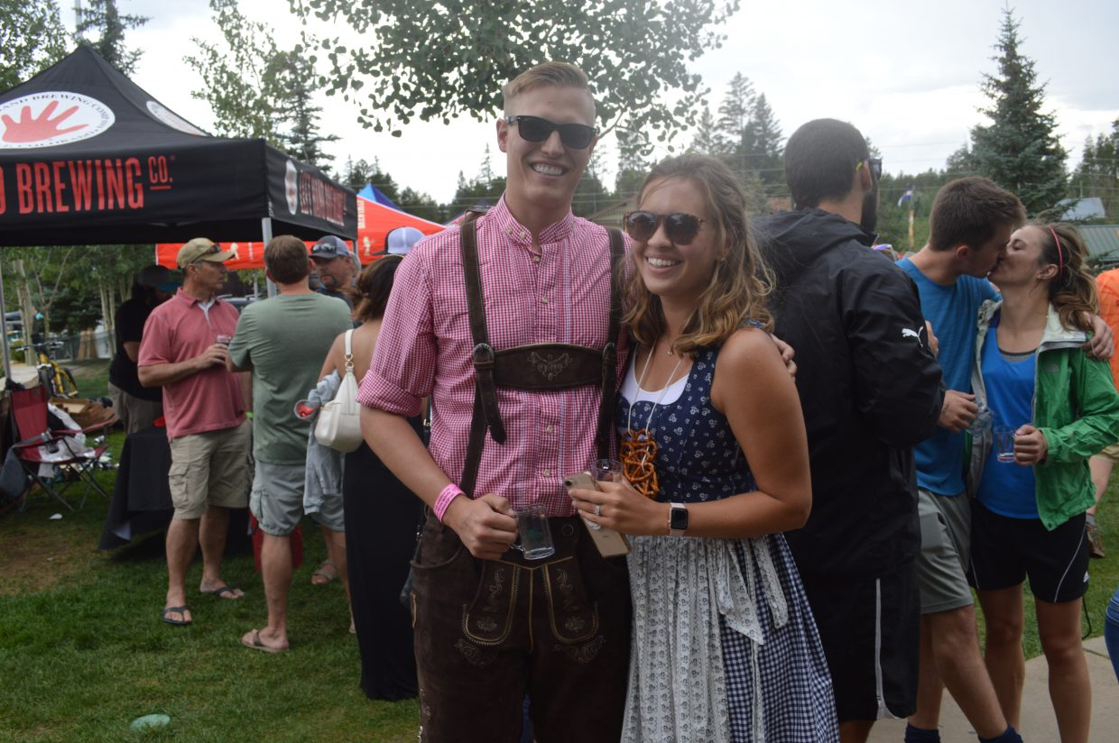 Kristin and Gage Crispe, from Lakewood, are extra festive and sport lederhosen and bar wench costumes.
