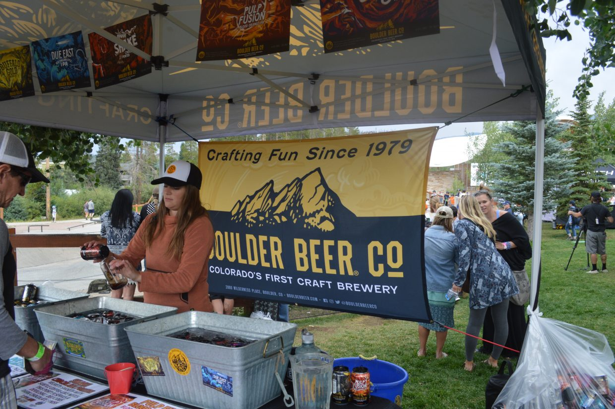 Sierra Koenig, a Boulder Beer Co representative, serves up a chocolate stout. Boulder Beer Co also offered two IPAs and a wheat.