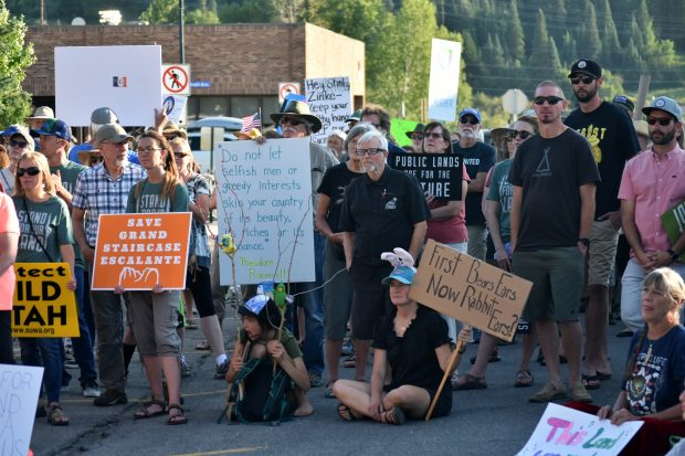 Protesters listen as Routt County Commissioner Tim Corrigan speaks at the