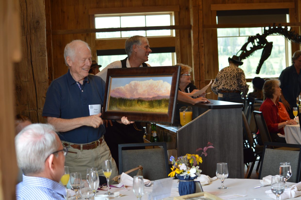 Local artist Pem Dunn helped auction his work