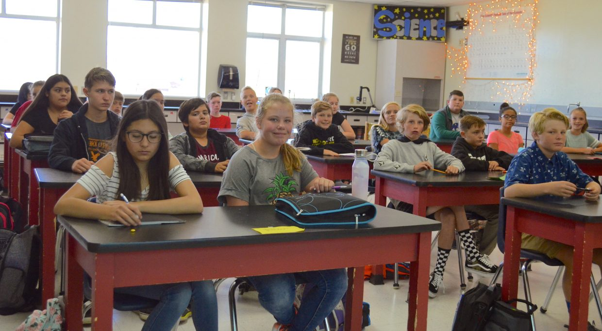 Eighth-grade students at East Grand Middle School sit in Rebecca Chernin's science class before the start of class.