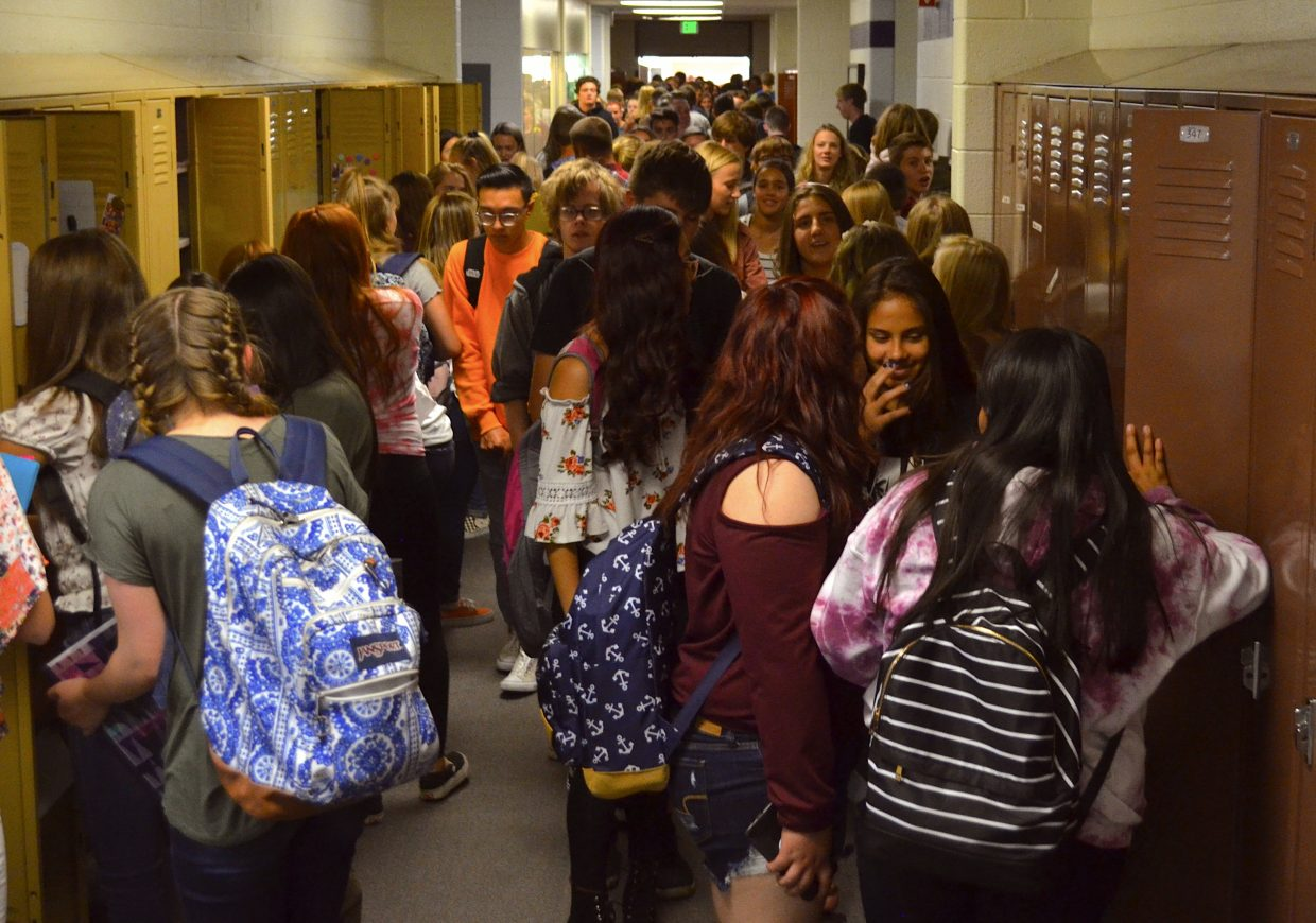 Dozens of high school students fill the halls at Middle Park High School as they make their way to their respective lockers before the start of class Monday morning.