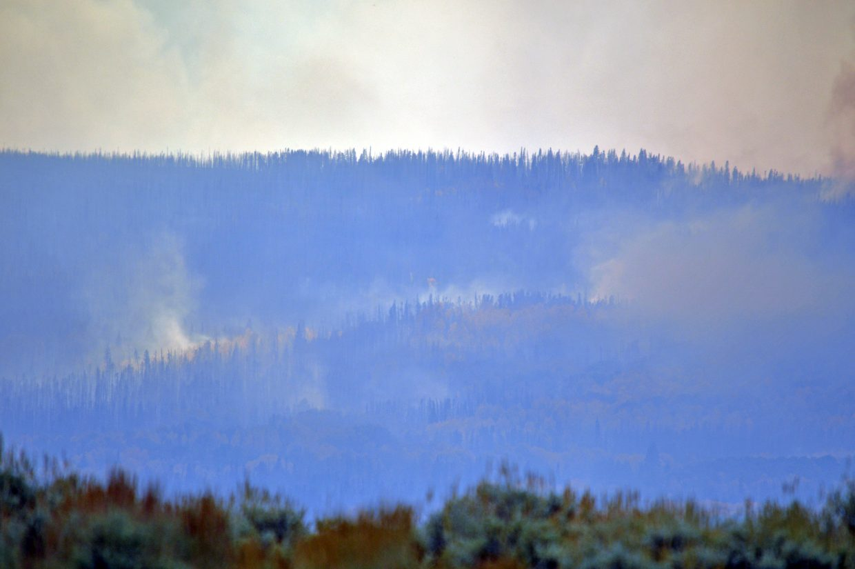 Hot spots dot areas in the trees at the head of the fire on Friday.