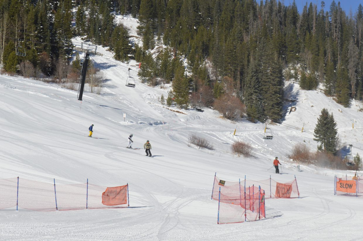 Some of the first skiers and riders coming down Larry Sale and Village Way in 2018.