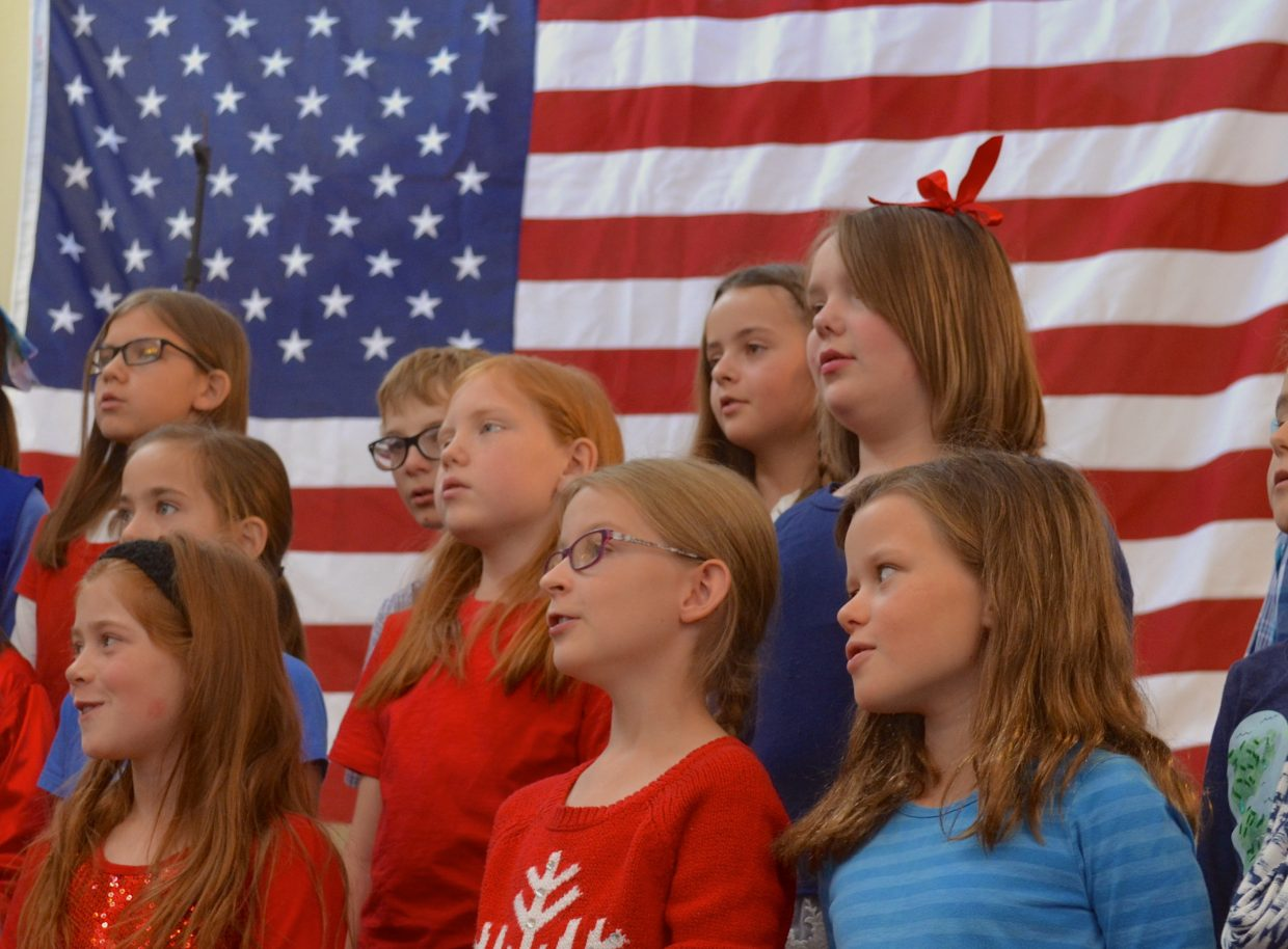 The Minne-singers, from Granby Elementary, sing patriotic and classic military songs to the veterans at Monday's Veterans Day event at Snow Mountain Ranch.