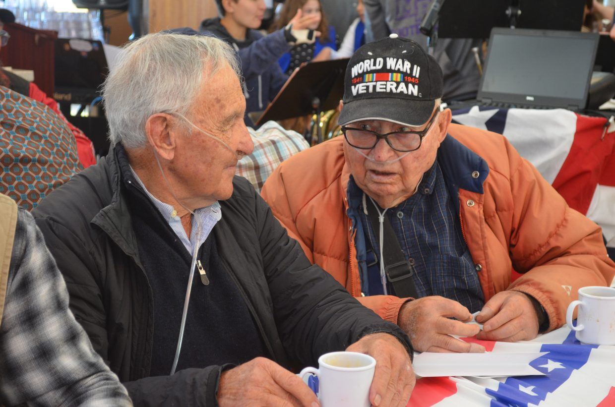 A pair of local veterans chat while awaiting the start of Monday morning's proceedings at Snow Mountain Ranch.
