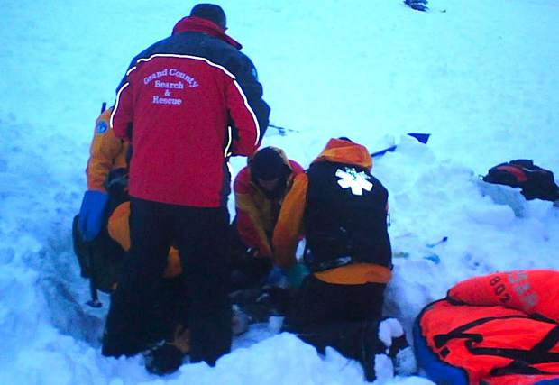 First responders work to save the life of a snowmobiler who perished near Gravel Mountain in late December 2008.