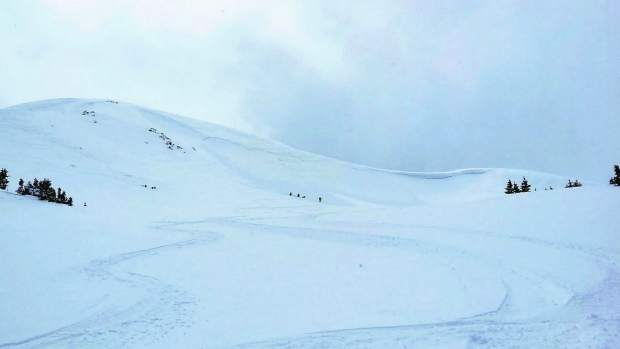 Team members from Grand County Search and Rescue evacuate a skier who was injured by a nonfatal avalanche near Berthoud Pass in early May 2015.