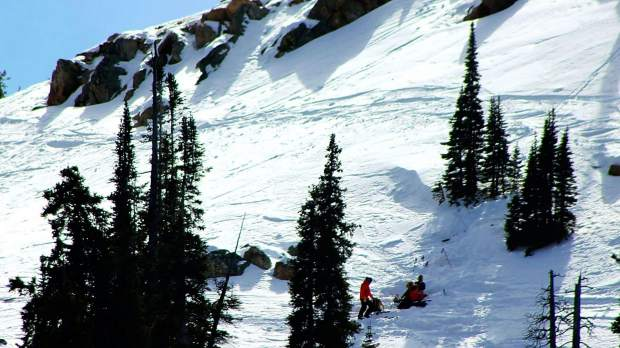 Search and Rescue members work to provide assistance to a skier who was injured in an incident on Berthoud Pass near the Current Creek trailhead in March 2016.