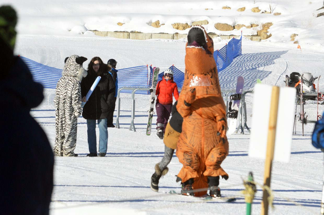 G-Rex gets a little help from Granby Ranch Sales Manager Jennifer Laspesa as she pushes the T-Rex across the terrain on opening day.