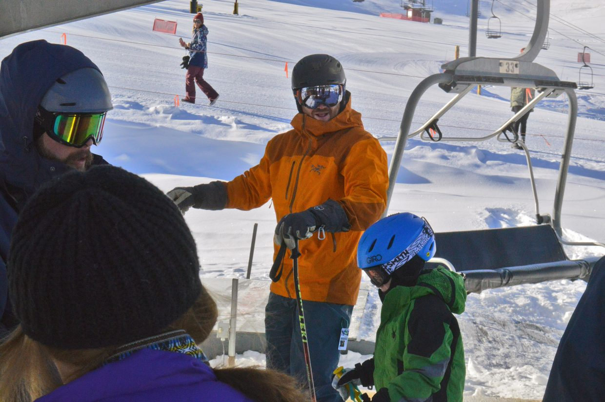 Kevin McKinney and his son, Henry, ready to claim the second chair on opening day at Ski Granby Ranch.