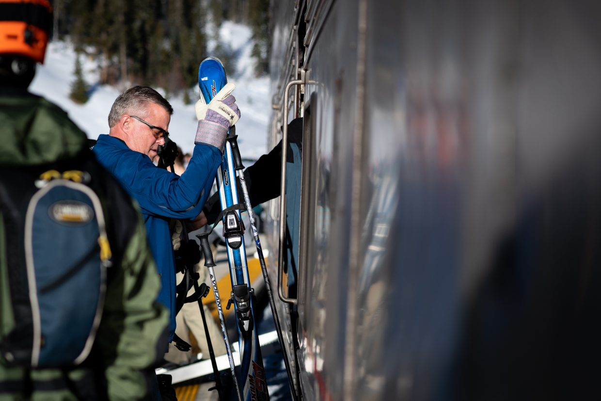 A man helps to unload skis from the nearly sold out Winter Park Express on Saturday.