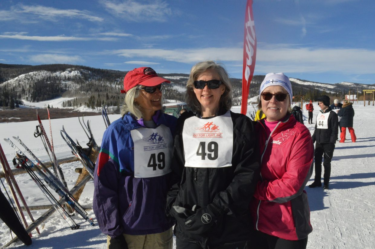 Bonnie Veegiard (center), of Houston, is flanked by her two guides Betsy Thomason (left), of West Townshen, Vermont, and Marita Johanson, of West Lebanon, New Hampshire. This is Veegiard's second year participating in Ski for Light and she said she has enjoyed her experience in Granby because of the great snow. Thomason and Johanson have been guides on and off for around seven years.