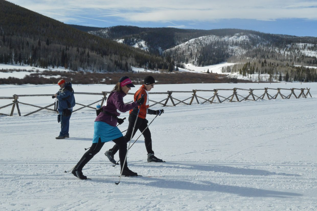 Ski for Light publicity and public relations chair Melinda Hollands and her guide race in the 10 kilometer finale on Saturday morning.