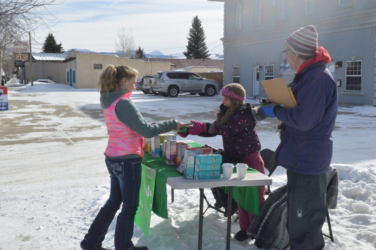 Leah Scott sells a box of thin mints, one of the more popular cookies.